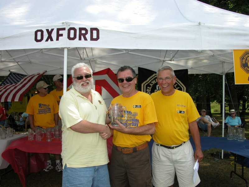 Steve Harding of Phila. MG Club accepts Best Attending Club Award from Chairman Tom Rippert & MC Lee Niner